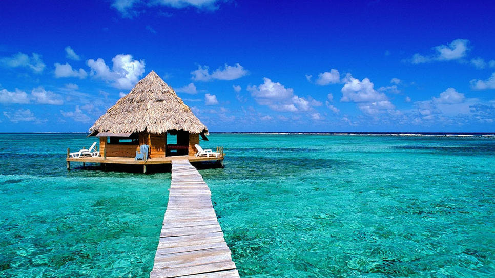 real estate in belize dock on beach
